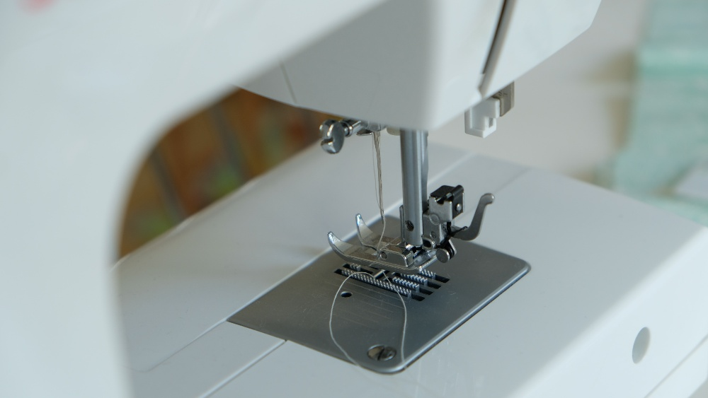 Image of Bobbin of a sewing machine but Why is My Thread Wrapping Around the Bobbin