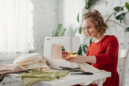 Image of a tailor using the Best Sewing Machine for Costume Design