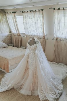 Image of a wedding dress but How Much Do Wedding Dress Alterations Cost?